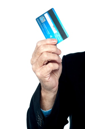 Cropped image of a man with a credit card in hand. White background. Stock Photo - 17034903