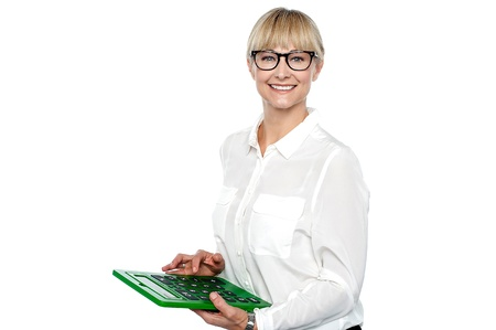 Secretary using large green calculator. Finger on subtract key. Stock Photo - 17044123