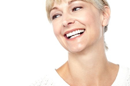 woman face: Closeup shot of a beautiful woman smiling heartily, cropped image. Stock Photo