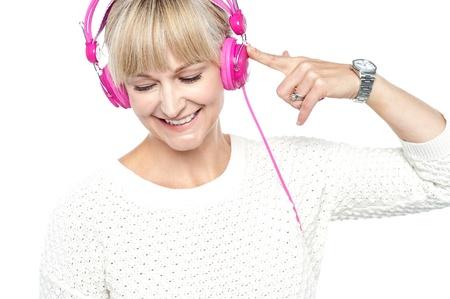 tuned: Fashion woman tuned into musical world and enjoying herself.