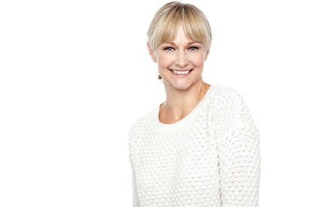 Smiling middle aged woman in trendy wear isolated over white background. Stock Photo - 17039061