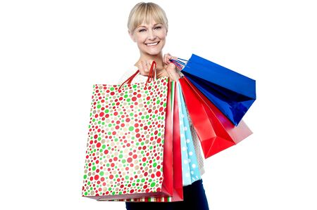 Vivacious woman holding colorful shopping bags isolated against white background. Stock Photo - 17081662