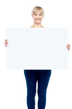 Charming woman displaying blank whiteboard to the camera. photo