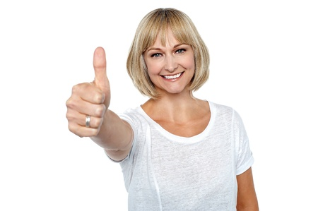 Successful middle aged blonde gesturing thumbs up. Stock Photo - 17038526