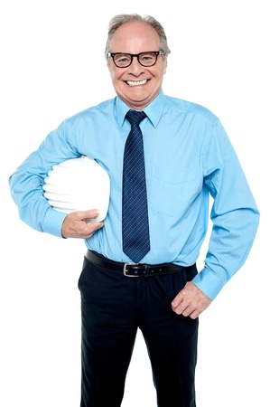Portrait of a confident senior male architect holding safety helmet. Stock Photo - 17038520
