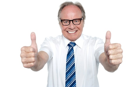 Cheerful boss gesturing double thumbs up to his team. Keep up the good work. Stock Photo - 17081665