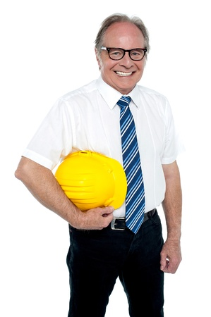 Smiling experienced architect posing with safety helmet isolated over white background. Stock Photo - 17038588