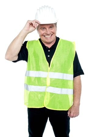 Mature construction worker holding his safety helmet and wearing fluorescent jacket. Stock Photo - 17039052