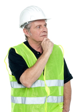 Shot of a thoughtful project engineer staring at site from distance. Stock Photo - 17039053