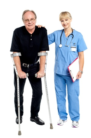 Physician supporting her courageous patient, helping him walk. photo