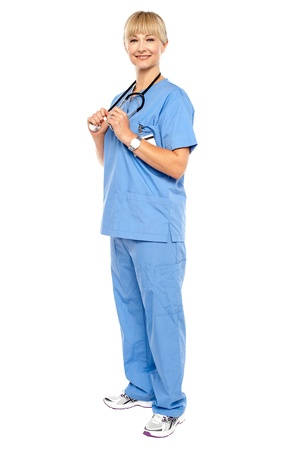 Casual portrait of a confident physician standing sideways. Isolated over white. Stock Photo - 17044096