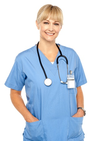 Pretty medical professional posing casually, stethoscope around her neck. Stock Photo - 17044637