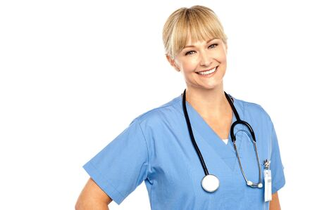 Snap shot of a charming young caucasian doctor flashing a warm smile. Stock Photo - 17044574