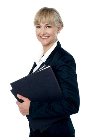 Pretty business woman ready to attend meeting, holding important files. photo