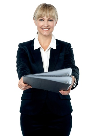 Stylish employee handing over the documents to her boss. Stock Photo - 17044346