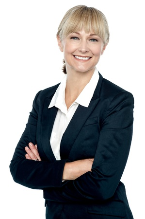 Smiling corporate head posing with folded arms isolated against white background. Stock Photo - 17044564