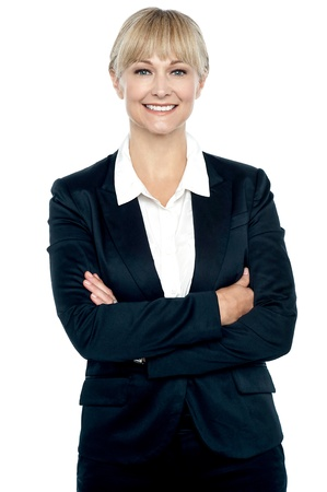 formals: Attractive smiling businesswoman posing with arms crossed.