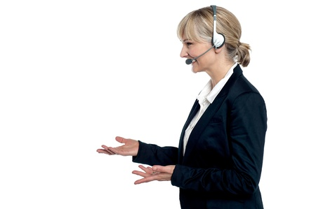 Female customer care agent in a conversation, gesturing with her hands. photo