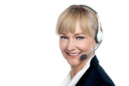 Closeup shot of a cheerful executive assisting customer over a call. photo
