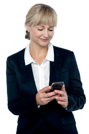 Shot of an entrepreneur reading a message on her mobile. All on white background. photo