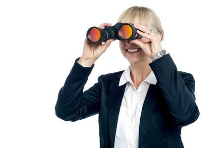 Isolation of an executive viewing through binoculars. Stock Photo - 17044356