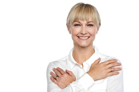 Business woman with arms crossed across her chest, flashing smile confidently. Stock Photo - 17044354
