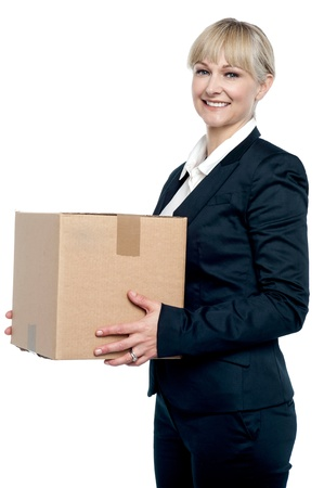 shifting: Corporate woman with a cardboard box in hand. Shifting her office. Stock Photo