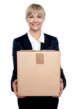 Its time to move to a new and bigger office. Business professional carrying a carton. photo