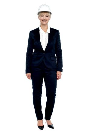 Full length portrait of a confident business architect. All against white background. photo