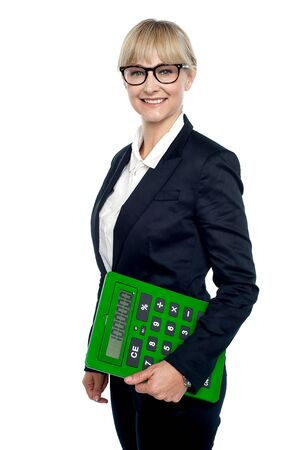 Confident corporate woman holding calculator isolated over white background. Stock Photo - 17044381