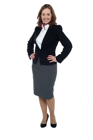 Charming businesswoman posing with hands on her waist, full length portrait over white. photo