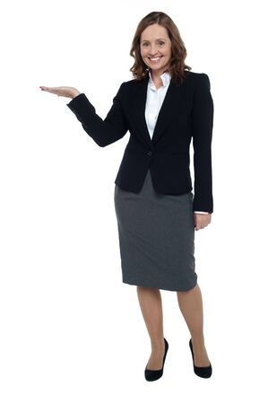 Cheerful executive presenting copy space with open palm. Full length shot. Stock Photo - 17203808