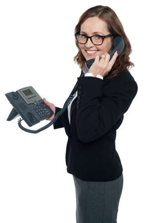 Business professional on phone turning her face towards the camera and smiling. Stock Photo - 17203798
