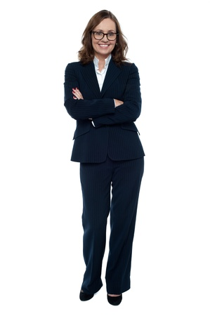 Executive in business attire standing arms folded, full length portrait. Stock Photo - 17203851