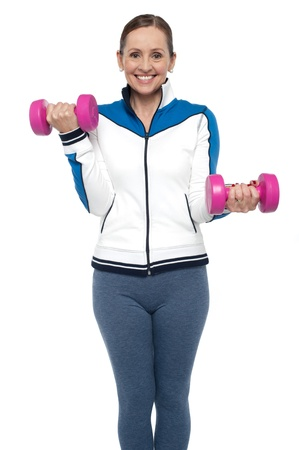 Isolation of an active woman posing with dumbbells, white background. Stock Photo - 17204297