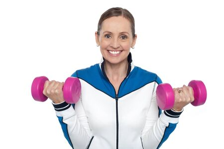 Happy woman carrying dumbbells in both hands isolated against white background. Stock Photo - 17204283