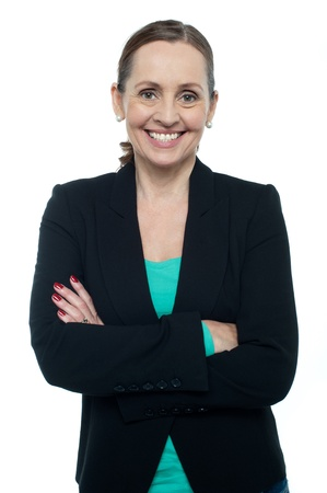 Profile shot of a cheerful confident woman posing with arms crossed. photo