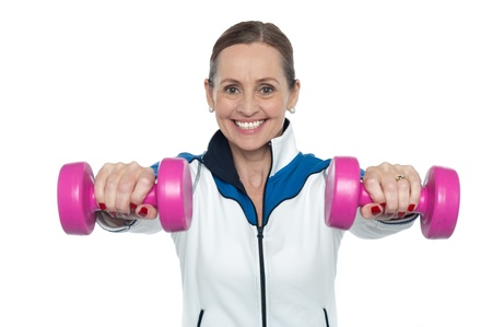 Female working out with pink dumbbells. Arms outstretched Stock Photo - 17204231