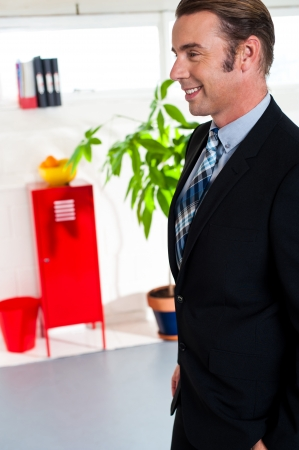 Experienced senior manager walking into new office, day one. Stock Photo - 17204384