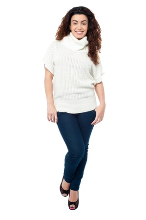 Full length portrait of a cheerful woman wearing high neck top isolated against white. Stock Photo - 17378578