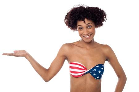 Sexy fashion model in stars and stripes bikini presenting copy space. Stock Photo - 17378563
