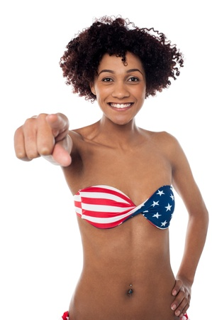 Alluring young American flag bikini woman pointing at you. Stock Photo - 17378621