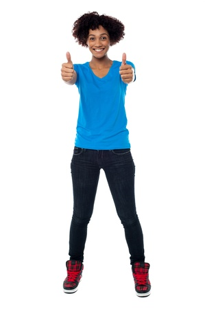 Afro American young woman showing double thumbs up to the camera. Stock Photo - 17378464
