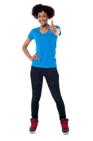 Stylish young model on white background gesturing thumbs up. Stock Photo - 17378468