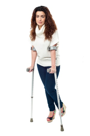 crutches: n limping with crutches, recovering from accident.
