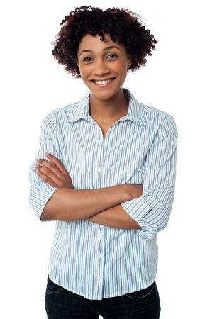 Fashionable young lady with arms crossed standing before the camera. Stock Photo - 17378682