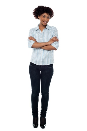 Full length casual portrait of a confident young female standing arms crossed. Stock Photo - 17378493