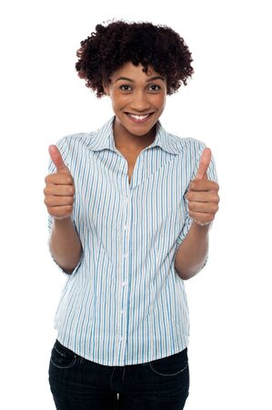 Excited young female gesturing double thumbs up to the camera isolated on white. Stock Photo - 17378644