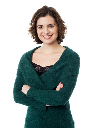 Elegant woman in warm clothing posing with arms crossed, standing against white Stock Photo - 18293455