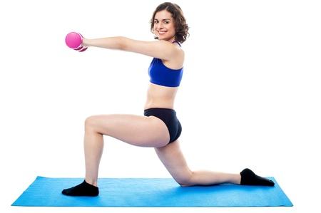 Happy female turning towards the camera while doing workout  Stock Photo - 18253601